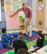 Matthew teaching 2nd graders poetry lesson.